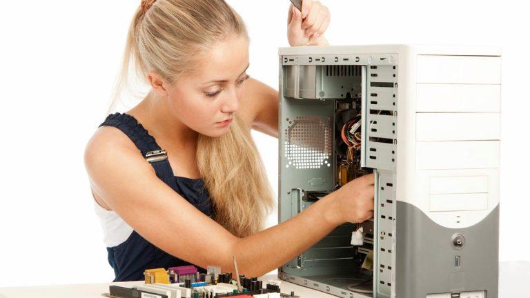 Girl repairing a desktop computer