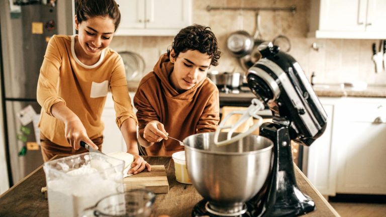 Teens cooking in a kitchen