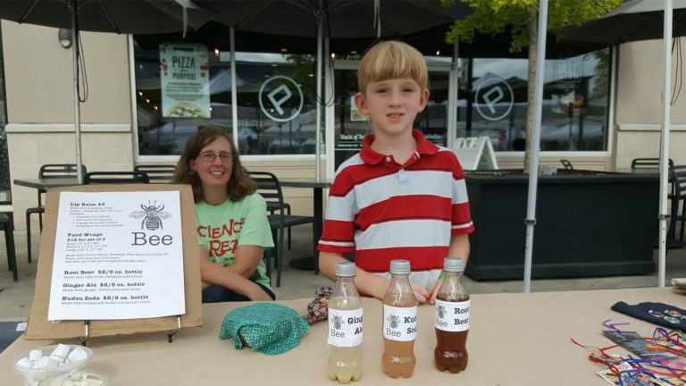 Selling products at a children's business fair