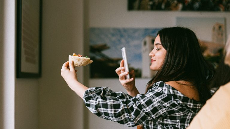 woman taking photos of food for instagram